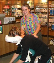 Sandy providing chair massage at an event at Nordstroms